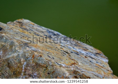 surface on stone with green blur background #1239541258