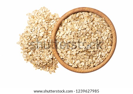 Oat flakes uncooked  in  wooden  bowl on white background concept of healthy eating vegan food #1239627985