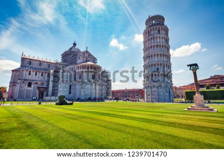 Splendid summer view of famous Leaning Tower in Pisa. Colorful morning scene with hundreds of tourists in Piazza dei Miracoli (Square of Miracles), Italy, Europe. Traveling concept background.
