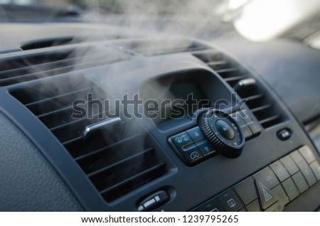 The process of cleaning car air conditioning. The air flow inside the car. Detail interior of car  Royalty-Free Stock Photo #1239795265