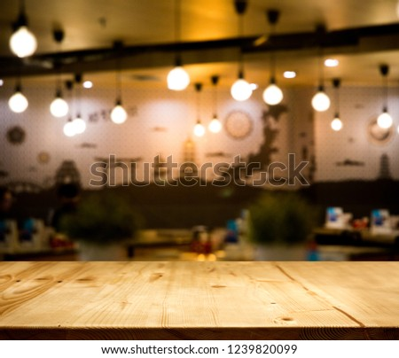 wood table top counter with night cafe club background in -use for display product on shelf with party time #1239820099