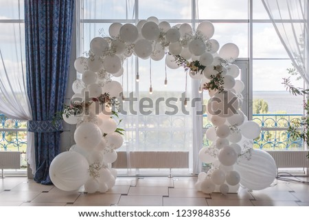 an arch of white balloons . festive decor for the wedding. decor of balloons and lights. wedding background. place of the wedding ceremony #1239848356