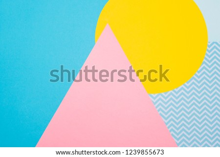 Texture background of fashion blue, yellow and purple papers in memphis geometry style. Flat lay, Top view. 80s or 90s concept