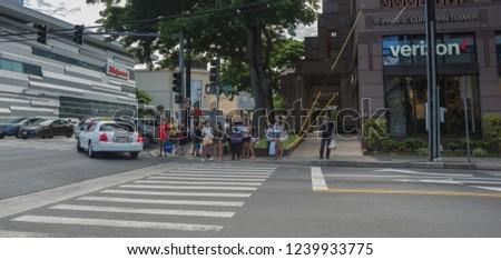 Honolulu, Hawaii, USA.  Nov. 25, 2018.  Street scene as people and cars crown the roadway to Waikiki. #1239933775