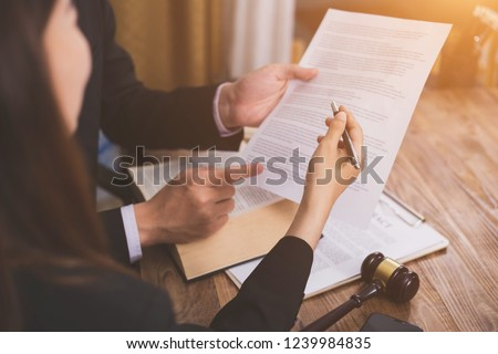 The hard work of an asian lawyer in a lawyer's office. Counseling and giving advice and prosecutions about the invasion of space between private and government officials to find a fair settlement. Royalty-Free Stock Photo #1239984835