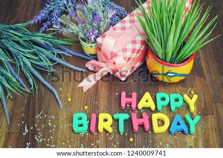 Happy birthday card with letters, gift  and flowers #1240009741