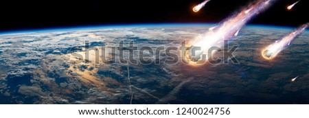 A comet, an asteroid, a meteorite glows, enters the earth's atmosphere. Attack of the meteorite. Meteor Rain. Kameta tail. End of the world. Elements of this image furnished by NASA. Mixed media. Royalty-Free Stock Photo #1240024756