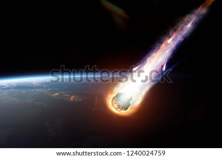 A comet, an asteroid, a meteorite glows, enters the earth's atmosphere. Attack of the meteorite. Meteor Rain. Kameta tail. End of the world. Elements of this image furnished by NASA. Mixed media. #1240024759
