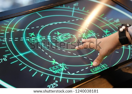 hand of man control airviation nevigate screen with moving detect technology. upgrade tech nology touch screen concept Royalty-Free Stock Photo #1240038181