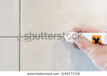Cleaning a tile joint with a joint pin #1240171150