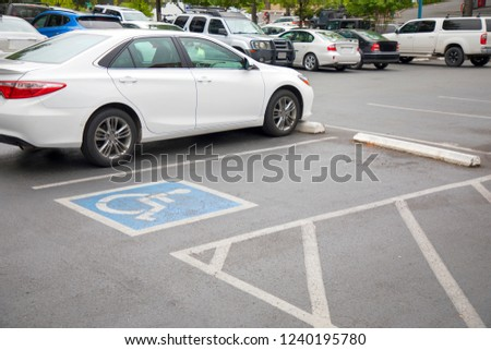 Free space Handicapped parking spot in motel or apartment, transportation infrastructure road markings. #1240195780