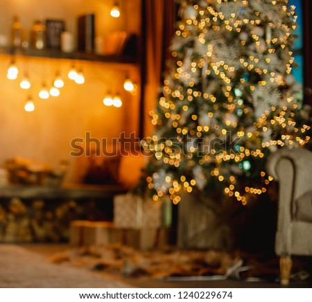 Home background. Christmas tree with gifts and reading corner decorated with garlands. Blurred. #1240229674