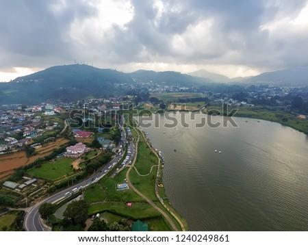 Nuwara Eliya is city in hill country of Central Province, Sri Lanka. Nuwara Eliya is overlooked by Pidurutalagala, tallest mountain. Nuwara Eliya was founded by Samuel Baker discoverer of Lake Albert #1240249861