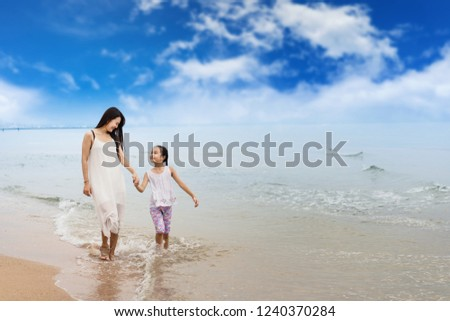 Family on the beach.happy family holiday travel summer.mother and daugter are resting on the beach.relaxing by the sea #1240370284