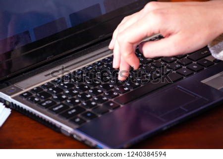 girl typing on a laptop keyboard, close-up #1240384594
