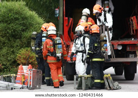 Nilai, Malaysia, 21 November,2018. The special forces Hazmat Fire and Rescue Department of Malaysia, making exercise a chemical spill. #1240431466