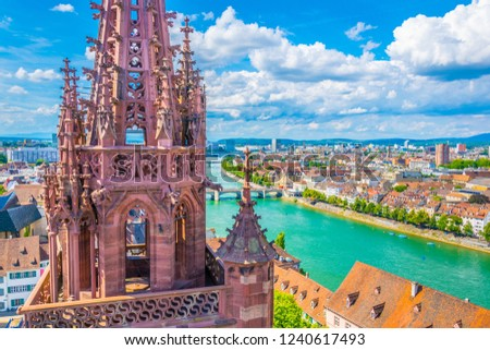 Riverside of Rhine in Basel dominated by majestic building of Munster church, Switzerland #1240617493