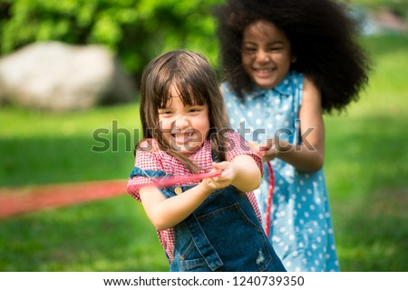 Little girls play fun game at summer camp. Children camp game recreation and summer fun activity. #1240739350