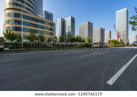 empty urban road with modern building in the city #1240766119