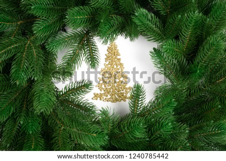Golden Christmas tree with fir branches. Top view. #1240785442