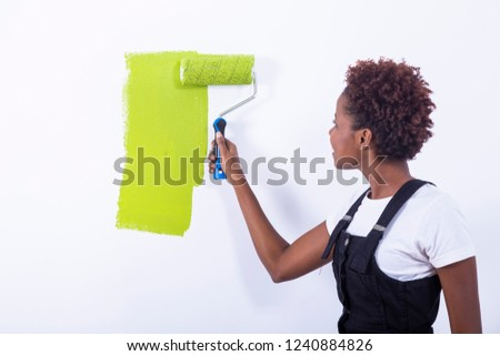 African black girl painting a wall #1240884826