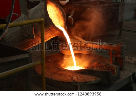 Molten iron pour from ladle into melting furnace ; foundry porcess #1240893958