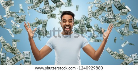 success, wealth and finances concept - happy young indian man celebrating triumph over blue and cash money falling background Royalty-Free Stock Photo #1240929880