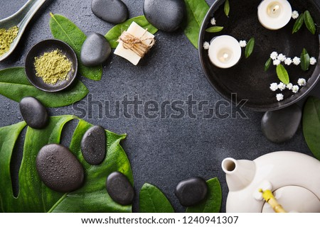 Spa Wellness Relax concept. Spa background with spa accessories on dark background. View from above with copy space.  #1240941307