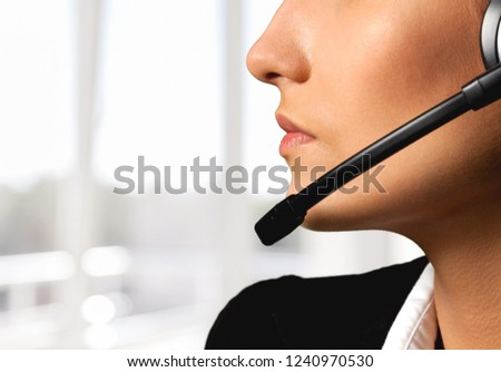 Young woman face call center #1240970530
