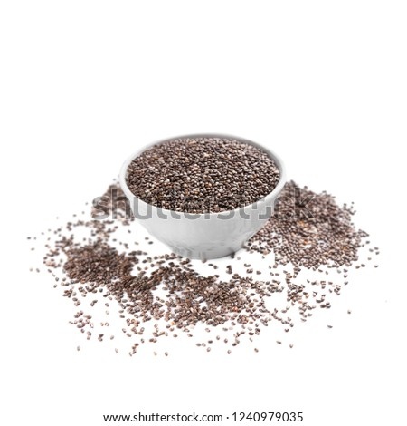 Chia superfood in ceramic bowl and scattered seeds on white background #1240979035