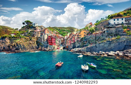 Sunny summer view of  Riomaggiore - Cique Terre sequence of hill cities. Wonderful morning view of Liguria, Italy, Europe. Splendid spring seascape of Mediterranean sea. Traveling concept background. Royalty-Free Stock Photo #1240982293