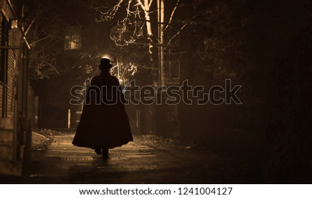 Jack the Ripper in action Royalty-Free Stock Photo #1241004127