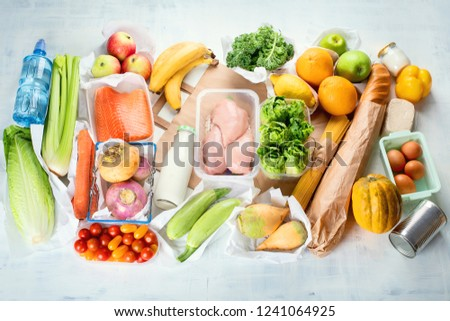 Grocery. Different health food. Grocery shopping concept. Balanced diet. Top view  #1241064925