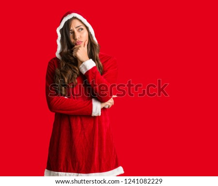 Full body young santa curvy woman thinking about an idea #1241082229
