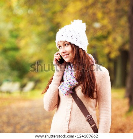 Beautiful young girl talking on cell phone. Beautiful Caucasian Teenager. Attractive young girl. #124109662