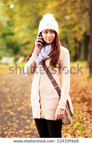 Beautiful young girl talking on cell phone. Beautiful Caucasian Teenager. Attractive young girl. #124109668