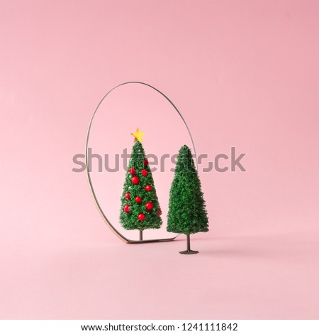 Christmas tree with mirror on pastel pink background. Minimal New Year decoration concept. #1241111842
