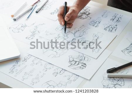 Animator designer Development designing drawing sketching development creating graphic pose characters sci-fi robot Cartoon illustration animation video game film production , animation design studio. #1241203828