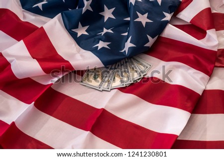 American dollar banknotes on national flag closeup #1241230801