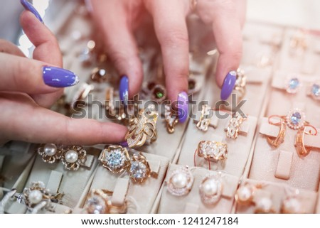 Female hands with golden jewellery in shop close up #1241247184