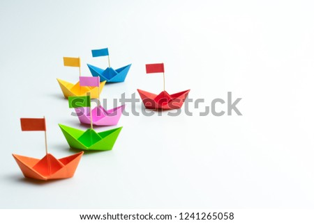 Business competition concept with Colorful paper ships on white background Royalty-Free Stock Photo #1241265058