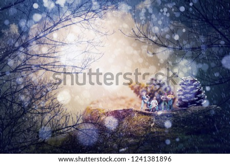 Group of friends( miniature) playing music,Fantastic winter landscape.Merry Christmas concept background. #1241381896
