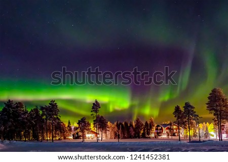 Aurora borealis (also known like northern or polar lights) beyond the Arctic Circle in winter Lapland. #1241452381