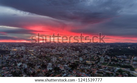Sunset in Brazil in a gorgeous sunset after a heavy rain with red sky in blood color, image made by drone at 250 meters high.  #1241539777
