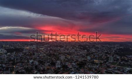 Sunset in Brazil in a gorgeous sunset after a heavy rain with red sky in blood color, image made by drone at 250 meters high.  #1241539780