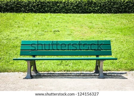 wooden park bench at a park #124156327