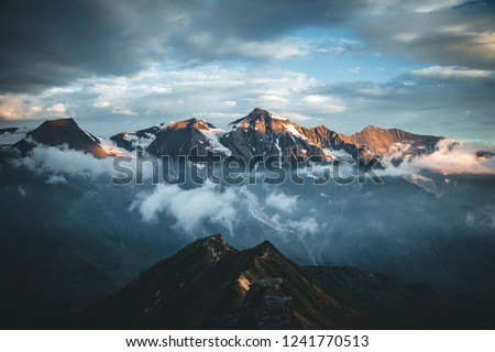 Dramatic view of high ridge. Location Grossglockner high alpine road, Austria, Europe. National park in Tyrol. Drone photography. Famous european travel destination. Discover the beauty of earth.