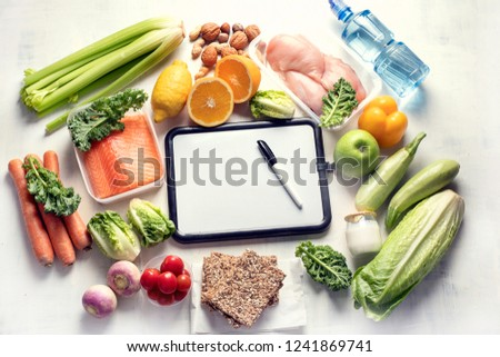 Healthy eating plan. Diet and meal planning. Top view. Flat lay #1241869741