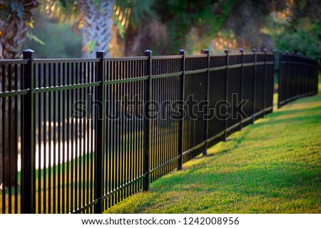 Black Aluminum Fence 3 Rails  Royalty-Free Stock Photo #1242008956