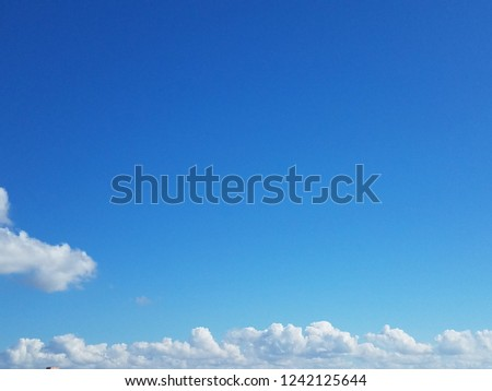White fluffy thick floating clouds with vibrant blue sky. Nobody peaceful serene texture background. atmosphere sky scape #1242125644